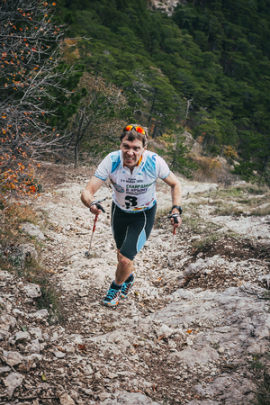 kilometre: Yalta, Russia - November 2, 2015: athlete leader of race up mountain on track during Mountain marathon Vertical kilometre AI-Petri