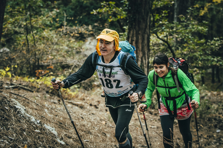 rival rivals rivalry season: Yalta, Russia - November 2, 2015: family athletes climb uphill on forest trail during Mountain marathon Vertical kilometre AI-Petri