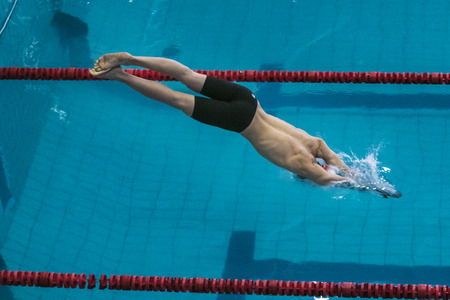 swimmer: Chelyabinsk, Russia - October 21, 2015: start athlete swimmer on distance freestyle during Championship of Chelyabinsk swimming Editorial