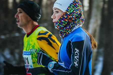 winter park: Ekaterinburg, Russia - November 14, 2015: closeup face beautiful girl athletes running through Park in winter during Urban winter marathon