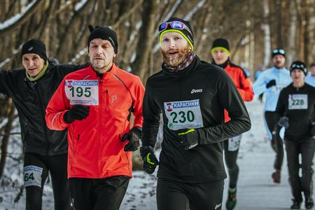 rival rivals rivalry season: Ekaterinburg, Russia - November 14, 2015: closeup group men athletes running through snowy Park alley during Urban winter marathon