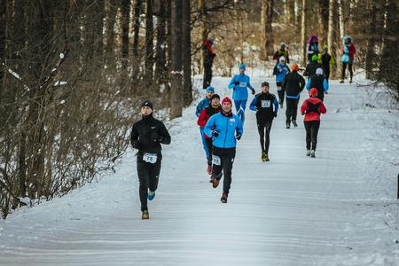 rival rivals rivalry season: Ekaterinburg, Russia - November 14, 2015: General plan running away people snow Park lane in December during Urban winter marathon
