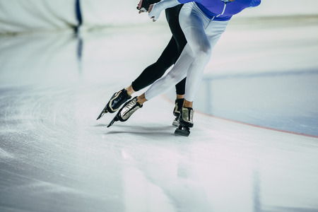 feet man athletes skater on ice go ice Palace of sports. competitions indoors. warm-up Standard-Bild