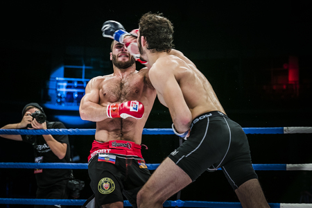 opponent: Chelyabinsk, Russia - December 5, 2015: athlete mixed martial arts gets strong jab hand to his opponent during Cup of Russia MMA
