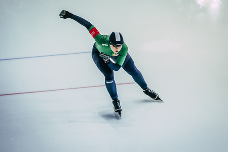 Chelyabinsk; Russia - December 3; 2015: view from top woman athlete speedskater sprint running race during Cup of Russia on speed skating