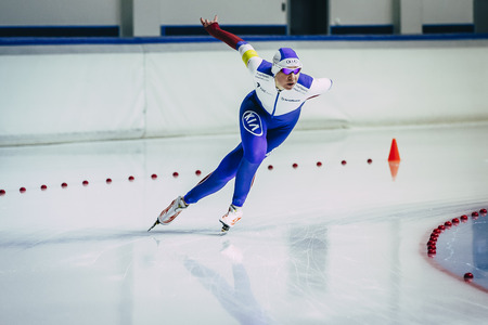 rival rivals rivalry season: Chelyabinsk; Russia - December 3; 2015: woman athlete runs speed skating sprint race on turn during Cup of Russia on speed skating