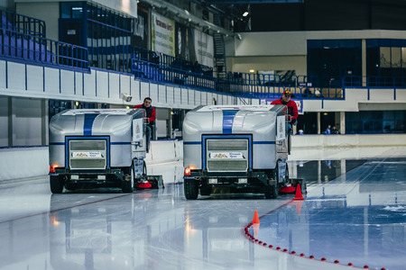 resurfacing: Chelyabinsk; Russia - December 3; 2015: break during competition. work two ice resurfacing machines for ice rink during Cup of Russia on speed skating Editorial