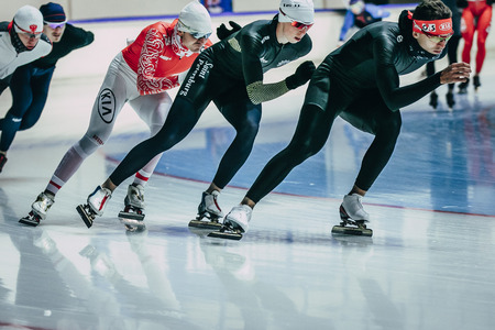 rival rivals rivalry season: Chelyabinsk; Russia - December 3; 2015: group men speedskater warming up before start during Cup of Russia on speed skating Editorial