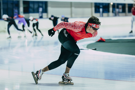 rival rivals rivalry season: Chelyabinsk; Russia - December 3; 2015: man athlete speedskater goes around turn sprint distance during Cup of Russia on speed skating Editorial