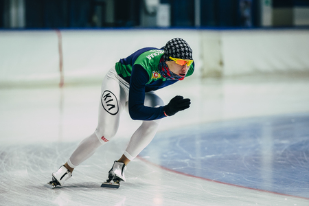 rival rivals rivalry season: Chelyabinsk; Russia - December 3; 2015: man athlete skater warmup before start. rolling on ice during Cup of Russia on speed skating