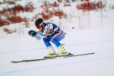 cup of russia: Magnitogorsk, Russia -  December 13, 2015: young male athlete in downhill during Russian Cup in alpine skiing Editorial