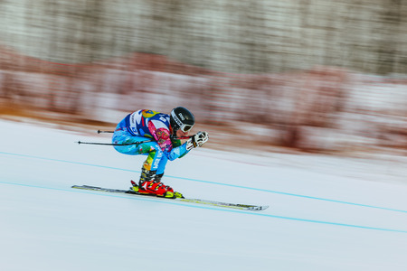 magnitogorsk: Magnitogorsk, Russia -  December 13, 2015: downhill racer young woman in competition. background blur effect during Russian Cup in alpine skiing Editorial