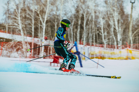 magnitogorsk: Magnitogorsk, Russia -  December 13, 2015: side view young skier after finish of race downhill during Russian Cup in alpine skiing Editorial