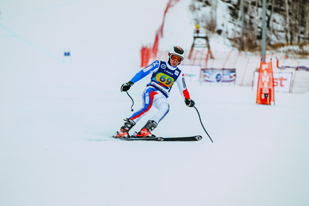 magnitogorsk: Magnitogorsk, Russia -  December 13, 2015: young athlete male skier after finish of race downhill from mountains during Russian Cup in alpine skiing