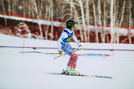 magnitogorsk: Magnitogorsk, Russia -  December 13, 2015: young girl athlete finish after downhill from mountain during Russian Cup in alpine skiing