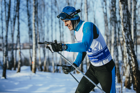 cross: Chelyabinsk, Russia -  December 19, 2015: closeup young athlete race skier in winter forest classic stylel during Championship of Chelyabinsk in cross-country skiing