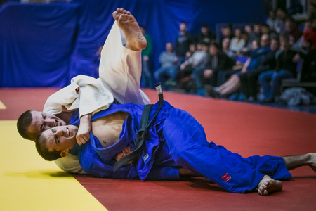 finals: Chelyabinsk, Russia -  December 20, 2015: fight on tatami two athletes wrestlers in finals during All-Russian competition on judo of memory Grigory Verichev Editorial