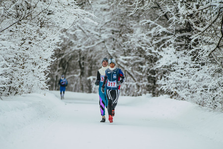 rival rivals rivalry season: Chelyabinsk, Russia -  January 5, 2016: athletes leaders of race run on track in winter forest during Chelyabinsk winter marathon