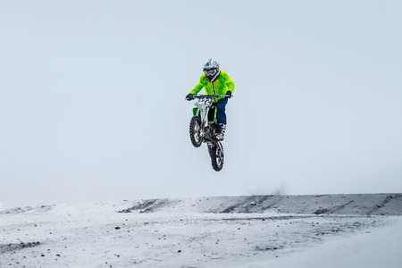 racer: motorcycle racer winter motocross, a snow track. jump over mountain