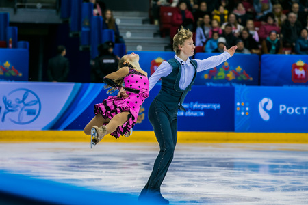 skaters: Chelyabinsk, Russia -  January 21, 2016: young pair skaters on ice sports arena during Championship of Russia figure skating juniors