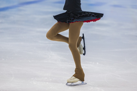 without legs: closeup slender legs girls athletes figure skater. part of body, without a face