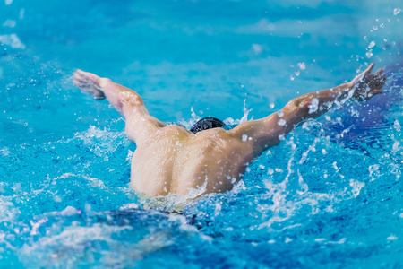 rival rivals rivalry season: young athlete swimmer swimming in pool
