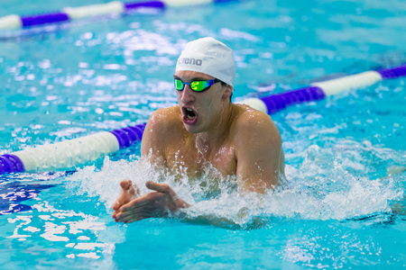 rivals rival rivalry season: Chelyabinsk, Russia - February 2, 2016: closeup male athlete swimming breaststroke in pool during Championship of Ural Federal District in swimming Editorial