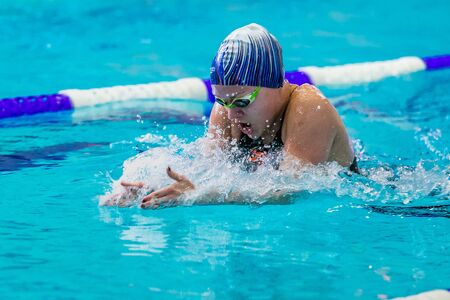 rivals rival rivalry season: Chelyabinsk, Russia - February 2, 2016: young female athlete swimming breaststroke in pool during Championship of Ural Federal District in swimming