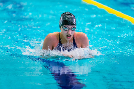 rival rivals rivalry season: Chelyabinsk, Russia - February 2, 2016: woman athlete is swimming breaststroke in pool during Championship of Ural Federal District in swimming