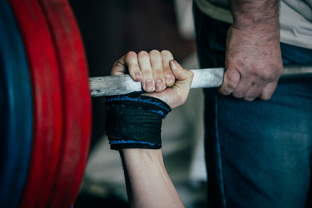 closeup of arm athlete in bench press at powerlifting competition Stock Photo