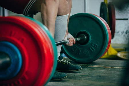squat: man of powerlifter squat competition deadlift