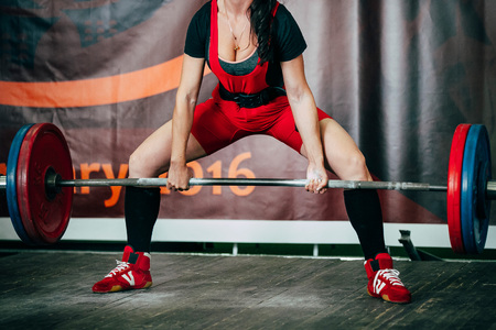 powerlifting: girl athlete exercise deadlift barbell at powerlifting competition Stock Photo