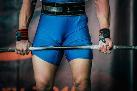 powerlifting: male powerlifter and barbell during competition of powerlifting deadlift Stock Photo