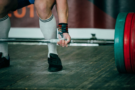 squat: athlete of powerlifter squat competition deadlift