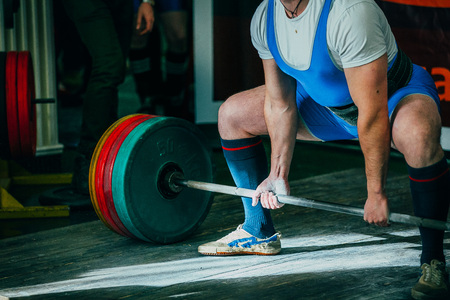 powerlifting: athlete of powerlifter deadlift squat during a powerlifting competition