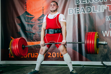 powerlifting: Chelyabinsk, Russia - February 12, 2016: powerlifter athlete will attempt to deadlift during West Asian championship 2016 WPC-AWPC powerlifting