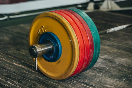 powerlifting: closeup barbell on a wooden floor during a powerlifting competition