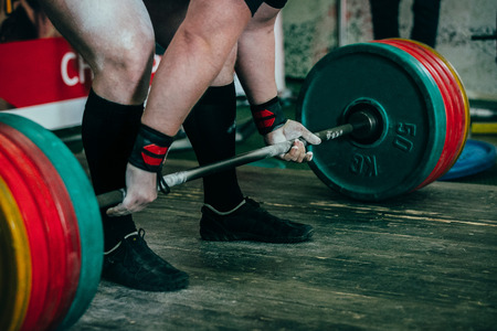 magnesia: male athlete of powerlifter preparing for deadlift of barbell Stock Photo