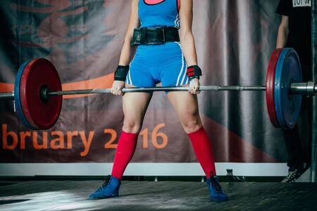 powerlifting: female athlete deadlift in competition in powerlifting Stock Photo