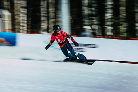 panning shot: Miass, Russia - February 20, 2016: panning shot girl snowboarder athlete after finish during Snowboard World Cup - Snowboard Cross Editorial
