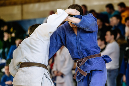 judokas fighters during fight in judo competitions