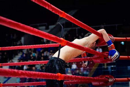 defeat MMA fighter on ropes of ring after fight