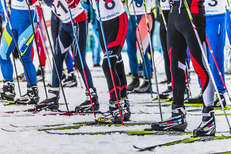 start to cross: Kyshtym, Russia -  March 26, 2016: Mass start men athletes skiers during Championship on cross country skiing