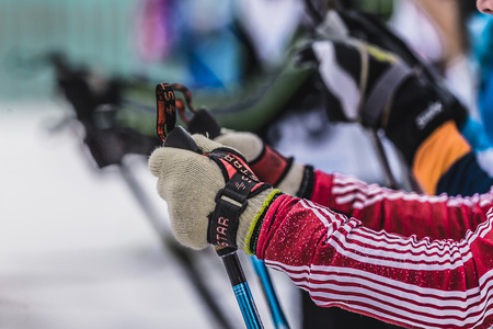 start to cross: Kyshtym, Russia -  March 26, 2016: Mass start of skiers athletes, closeup of hands and ski poles during Championship on cross country skiing