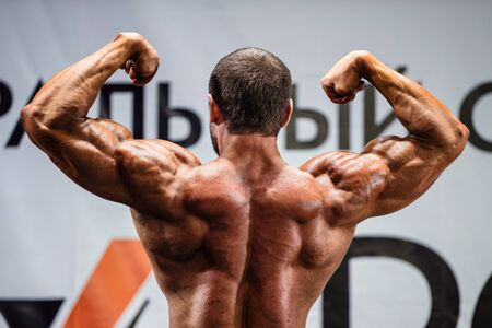quadriceps: athlete bodybuilder in competition. view from back Stock Photo