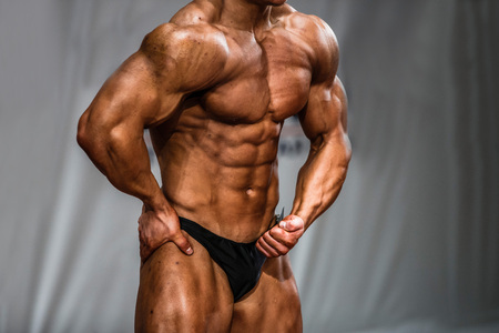 professional athlete bodybuilder bodybuilding competition. abdominal muscles and biceps