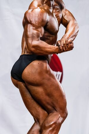 tension: male professional athlete to compete in bodybuilding. tension biceps Stock Photo