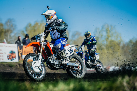 dirt: Miasskoe, Russia - May 02, 2016: athlete on bike from under wheels of earth and dirt during Cup of Urals motocross