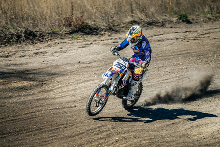 rear wheel: Miasskoe, Russia - May 02, 2016: racer on a motorcycle rides on rear wheel during Cup of Urals motocross