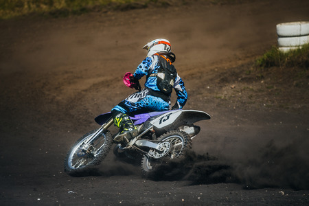 skid: Miasskoe, Russia - May 02, 2016: racer on a motorcycle skid on race track during Cup of Urals motocross Editorial